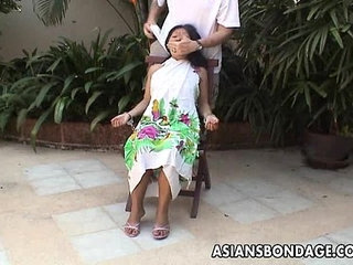 Asian teen tied up and hand cuffed on a chair | asianbondage